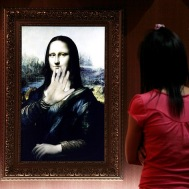 A visitor looks at a three-dimensional, holographic version of the Mona Lisa portrait in Beijing